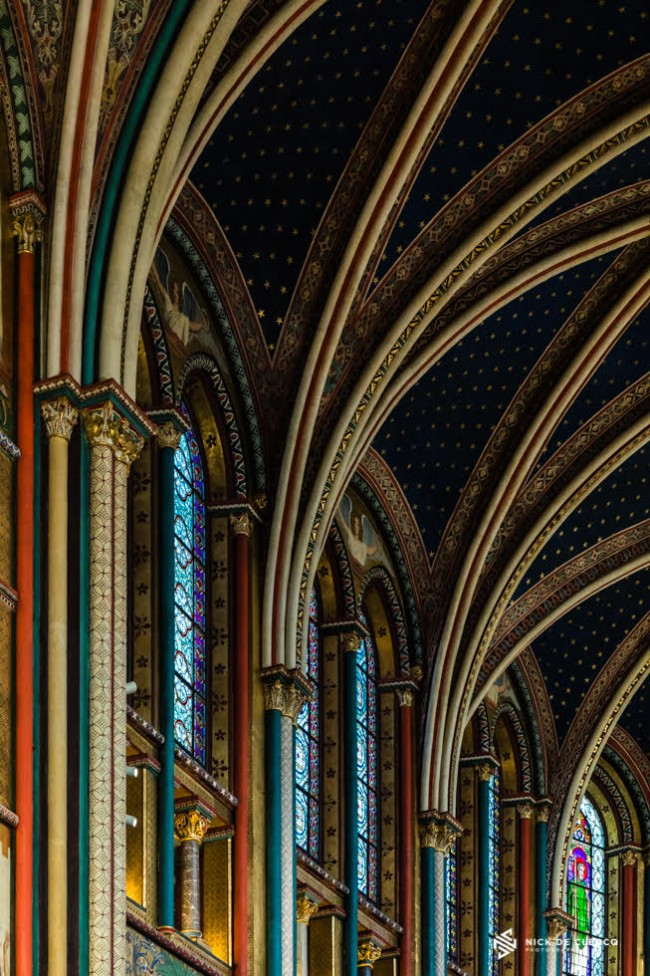 An architectural photo showing the interior of a church in Paris, by Nick De Clercq