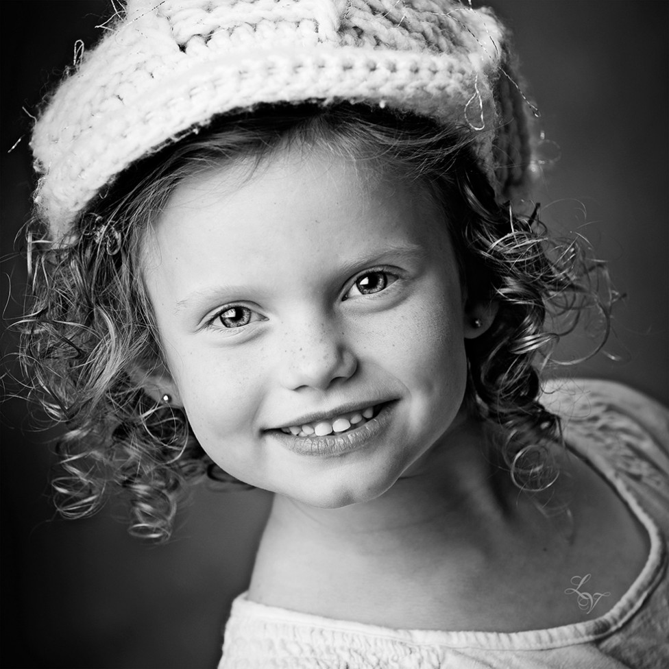 A portrait of a little girl with ringlets by Louise Vessey