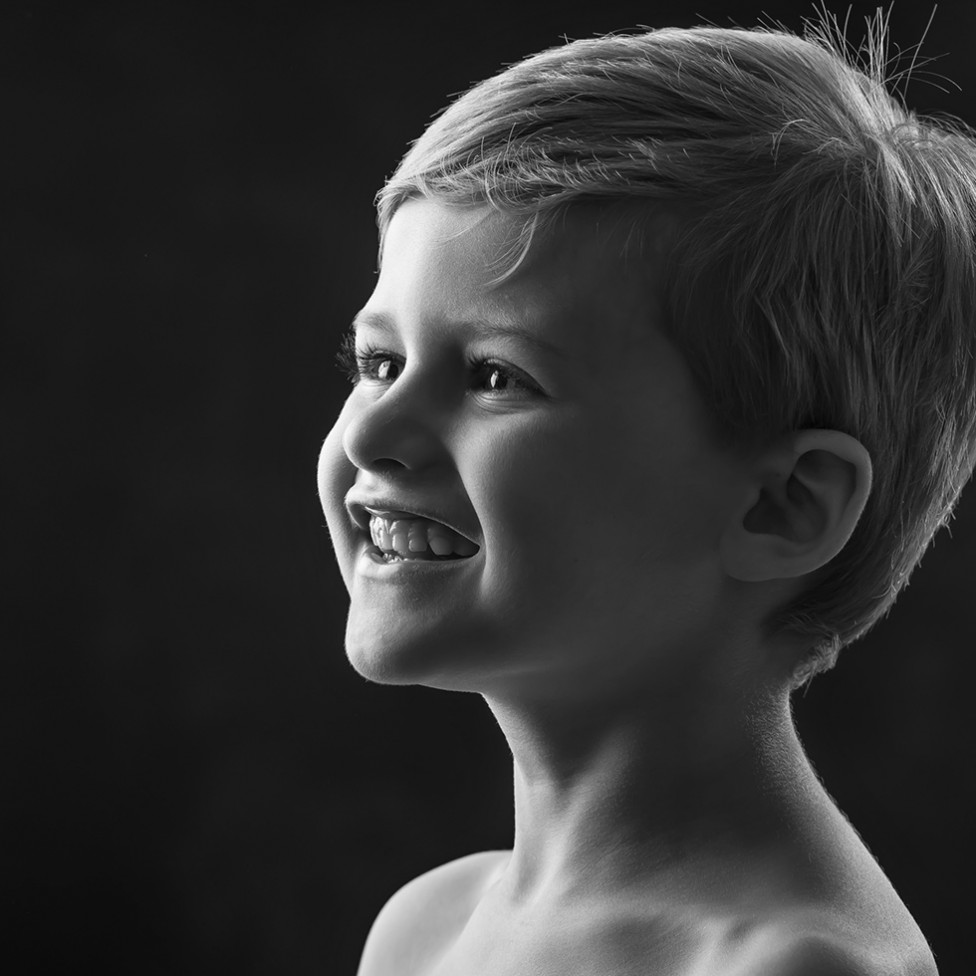 A timeless black and white portrait of a young boy by Louise Vessey