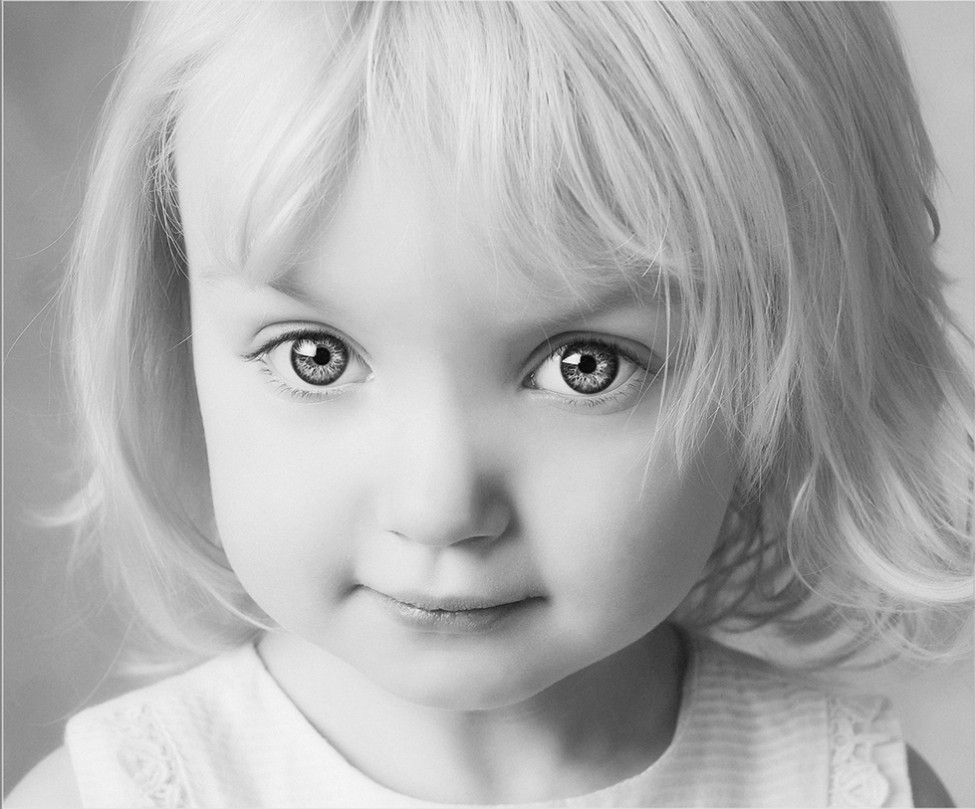 A beautiful black and white child portrait by Louise Vessey